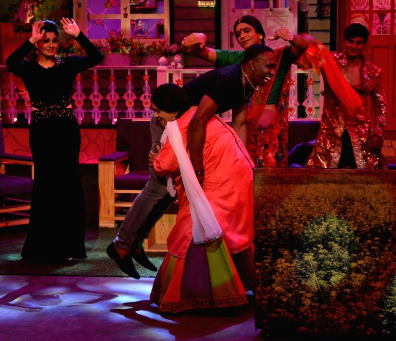 Kiku Sharda and Sunil Grover with DJ Dwayne Bravo on on the sets of Sony Entertainment Television`s The Kapil Sharma Show, in Mumbai on May 16, 2016.