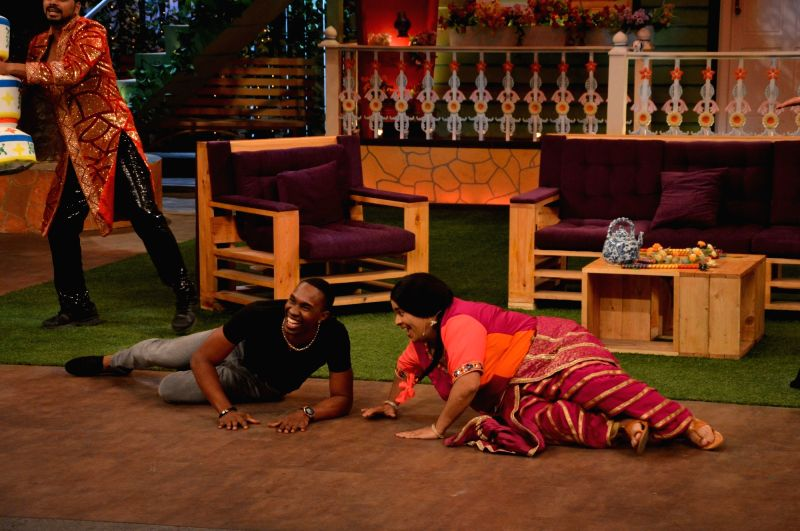 Kiku Sharda teaching DJ Dwayne Bravo on the sets of Sony Entertainment Television`s The Kapil Sharma Show, in Mumbai on May 16, 2016.