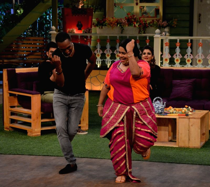 Kiku Sharda teaching DJ Dwayne Bravo some bollywood moves on the sets of Sony Entertainment Television`s The Kapil Sharma Show, in Mumbai on May 16, 2016.