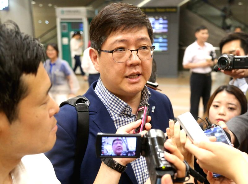 Kim Hong-gul, head of the Korean Council for Reconciliation and Cooperation civic group, talks to reporters at an airport in Beijing on July 19, 2018, after a trip to North Korea. Kim said ...