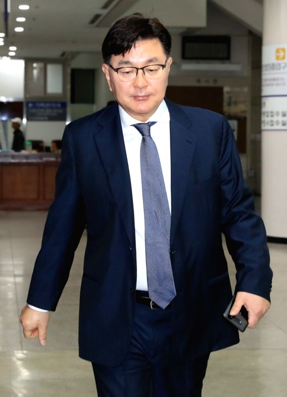 Kim Young-jae, head of a plastic surgery clinic, arrives at the Seoul Central District Court on May 18, 2017. The court sentenced Kim to 18 months in prison, suspended for three years, for giving ...