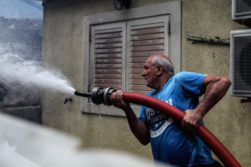 KINETA (GREECE), July 23, 2018 A man tries to put out flames at Kineta near Athens, Greece, July 23, 2018. Western and Eastern Attica were declared in state of emergency by local ...