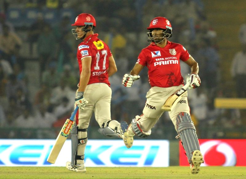 Kings XI Punjab batsmen Marcus Stoinis and Wriddhiman Saha in action during an IPL match between Kings XI Punjab and Delhi Daredevils at Punjab Cricket Association IS Bindra Stadium in Mohali ...