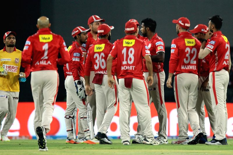 Kings XI Punjab celebrate fall of a wicket during an IPL 2017 match between Kings XI Punjab and Royal Challengers Bangalore at Holkar Cricket Stadium in Indore on April 10, 2017.