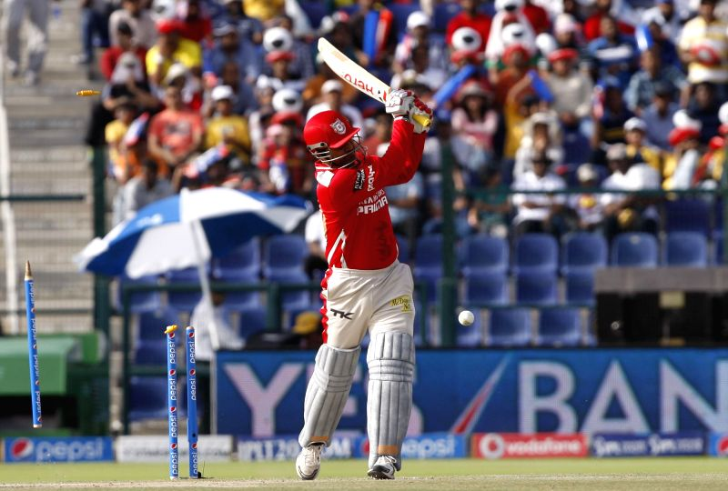 Kings XI Punjab player Virender Sehwag gets bowled during the third match of IPL 2014 between Chennai Super Kings and Kings XI Punjab, played at Sheikh Zayed Stadium in Abu Dhabi of United Arab ...