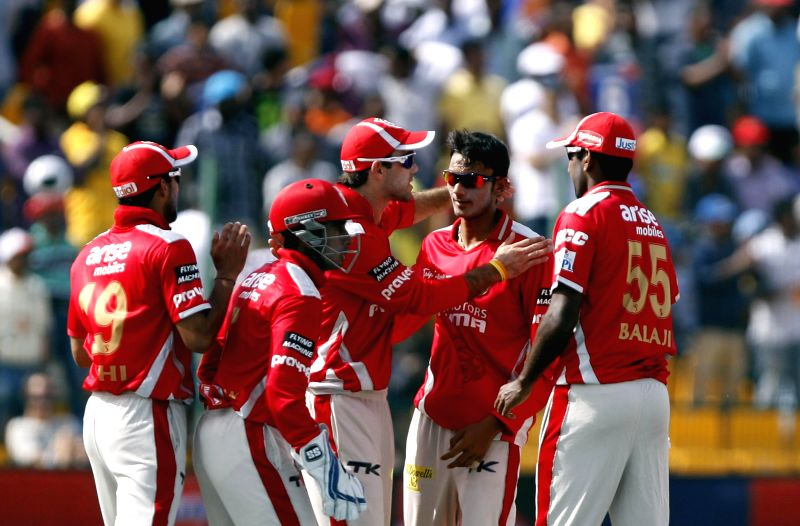 Kings XI Punjab players celebrate fall of a wicket during the third match of IPL 2014 between Chennai Super Kings and Kings XI Punjab, played at Sheikh Zayed Stadium in Abu Dhabi of United Arab ...