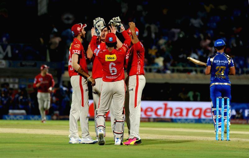 Kings XI Punjab players celebrate fall of a wicket during an IPL match between Mumbai Indians and Kings XI Punjab at Dr YS Rajasekhara Reddy ACA-VDCA Cricket Stadium in Visakhapatnam ... - Rajasekhara Reddy A