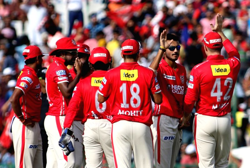 Kings XI Punjab players celebrate fall of a wicket during an IPL 2017 match between Kings XI Punjab and Delhi Daredevils at Punjab Cricket Association IS Bindra Stadium in Mohali on April 30, ...