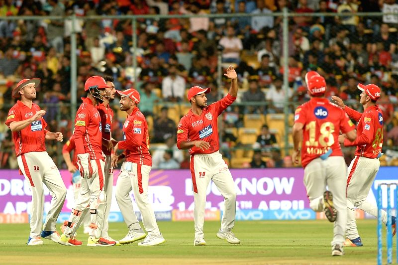 Kings XI Punjab players celebrate fall of a wicket during an IPL 2018 match between Kings XI Punjab and Royal Challengers Bangalore at M.Chinnaswamy Stadium in Bengaluru on April 13, 2018.
