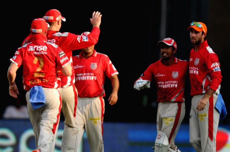 Kings XI Punjab players celebrates fall of a wicket during the 22nd match of IPL 2014 between Kings XI Punjab and Mumbai Indians, played at Wankhede Stadium in Mumbai on May 3, 2014.