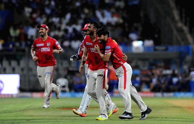 Kings XI Punjab players celebrates fall of a wicket in action during an IPL 2017 match between Mumbai Indians and Kings XI Punjab at Wankhede Stadium in Mumbai on May 11, 2017.