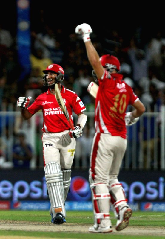 Kings XI Punjab players David Miller and Cheteshwar Pujara celebrate their win against Rajasthan Royals in the seventh match of IPL 2014 between Rajasthan Royals and Kings XI Punjab, played at ...