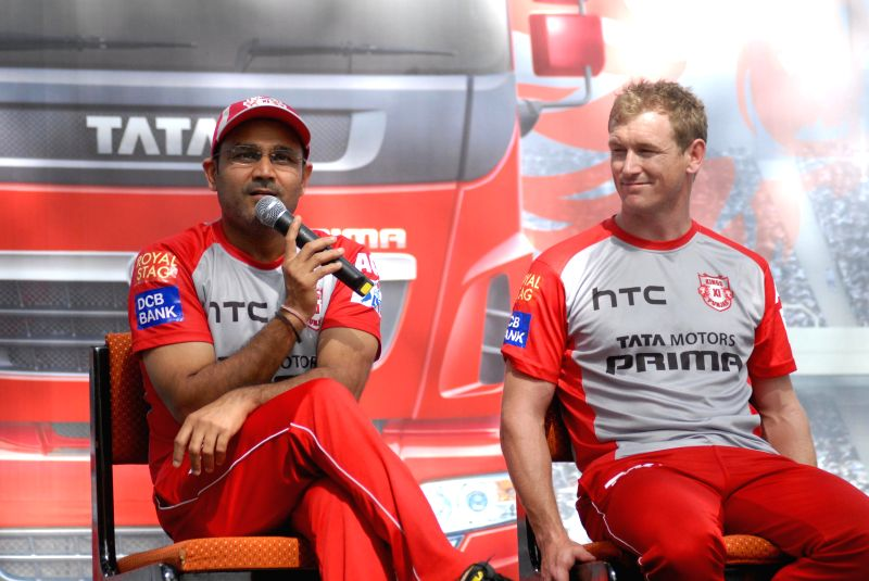 Kings XI Punjab players Virender Sehwag and George Bailey during a programme organised by Tata Motors at its plant in Pune on April 6, 2015.