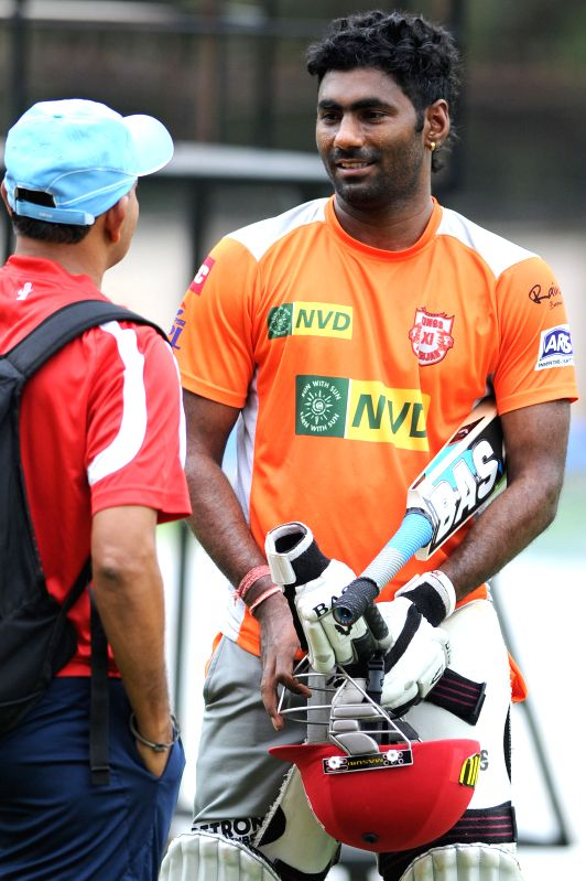 :Kings XI Punjab team player Parvinder Awana practicing practicing for the tomorrow`s match against RCB at Chinnaswamy Stadium in Bangalore on May 13, 2013. (Photo: IANS).
