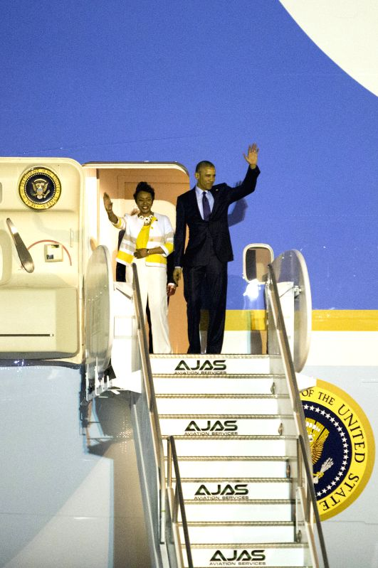 U.S. President Barack Obama (R) arrives at the Norman Manley International Airport in Kingston, Jamaica, April 8, 2015. Barack Obama arrived at the Norman Manley ...