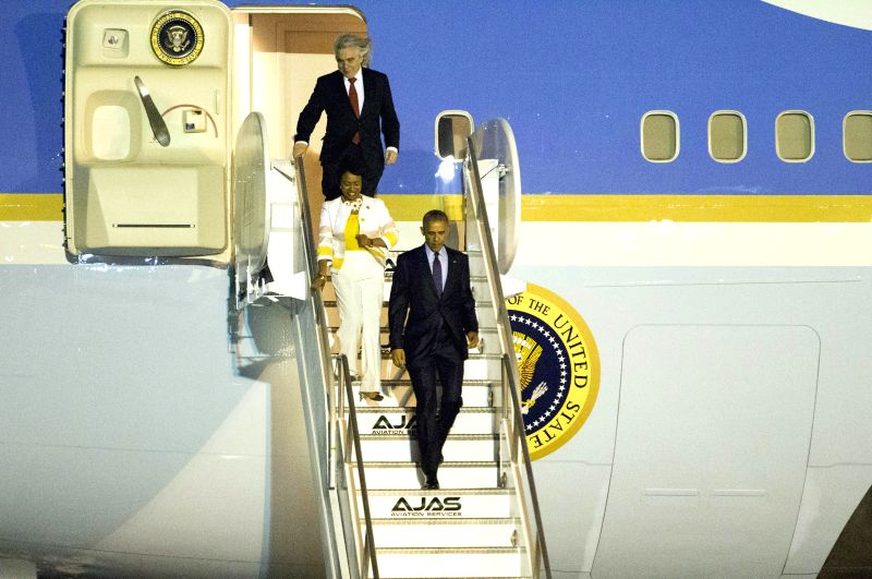 U.S. President Barack Obama (front) arrives at the Norman Manley International Airport in Kingston, Jamaica, April 8, 2015. Barack Obama arrived at the Norman ...