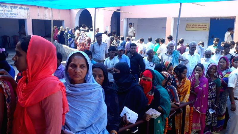 Kishanganj: People stand in queue to cast vote during the second phase of Lok Sabha polls, in Bihar's Kishanganj, on April 18, 2019. (Photo: IANS)
