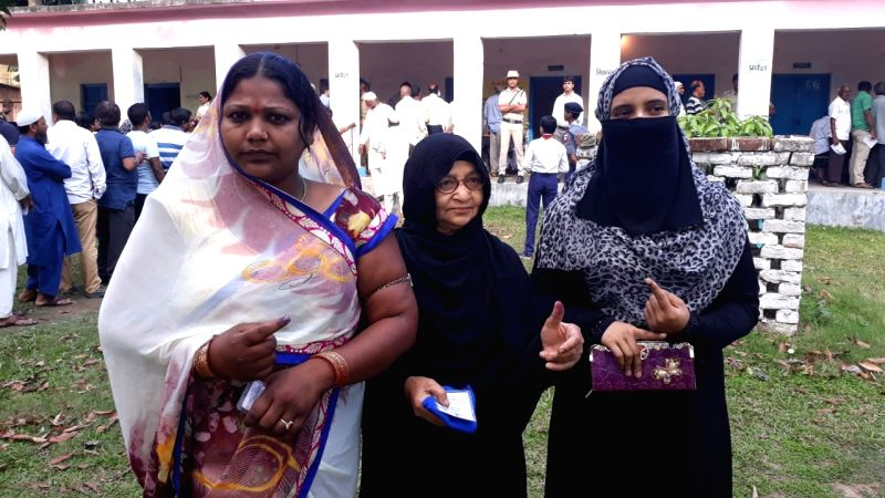 Kishanganj: Women shows their forefinger marked with indelible ink after casting vote during the second phase of Lok Sabha polls, in Bihar's Kishanganj, on April 18, 2019. (Photo: IANS)