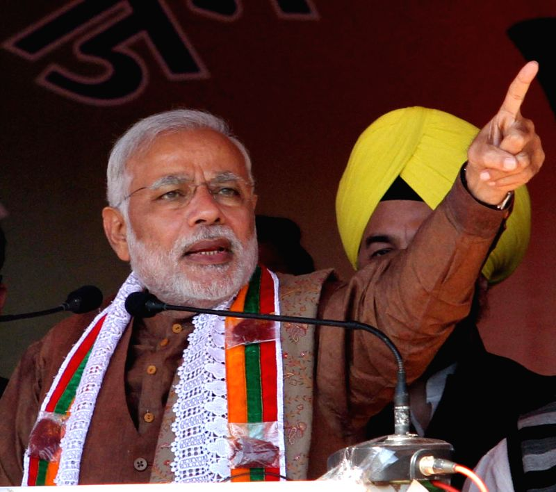 Prime Minister Narendra Modi during a rally ahead of upcoming J&K Assembly Polls in Kishtwar District of the Jammu region, J&K on Nov 22, 2014. - Narendra Modi