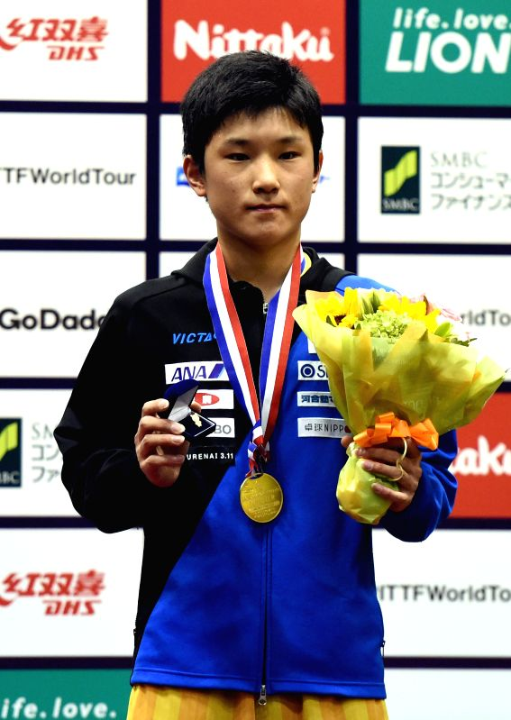KITAKYUSHU, June 10, 2018 - Tomokazu Harimoto of Japan celebrates on the podium after winning the men's singles final against Zhang Jike of China at the 2018 ITTF World tour Japan Open in Kitakyushu, ...