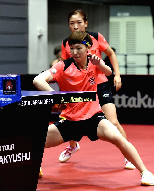 KITAKYUSHU, June 8, 2018 - Liu Shiwen and Wang Manyu (Front) of China return the ball during the women's doubles round of 16 match against Lin Ye and Yu Mengyu of Singapore at the 2018 ITTF World ...
