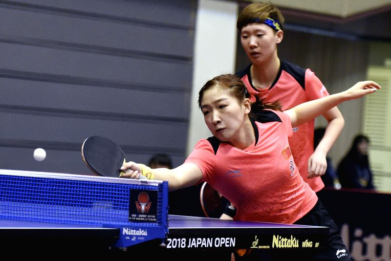 KITAKYUSHU, June 8, 2018 - Liu Shiwen (Front) and Wang Manyu of China return the ball during the women's doubles round of 16 match against Lin Ye and Yu Mengyu of Singapore at the 2018 ITTF World ...