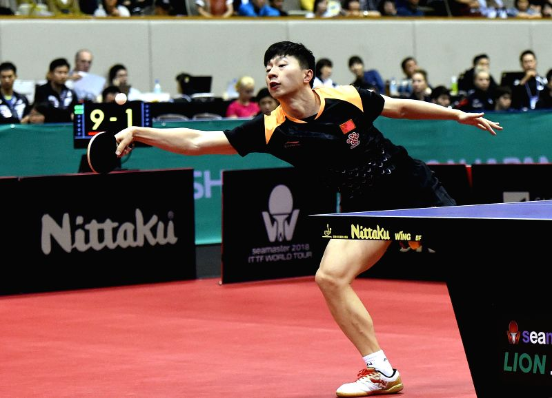KITAKYUSHU, June 8, 2018 - Ma Long of China returns the ball during the men's singles round of 32 match against Chiang Hung-Chieh of Chinese Taipei at the 2018 ITTF World tour Japan Open in ...