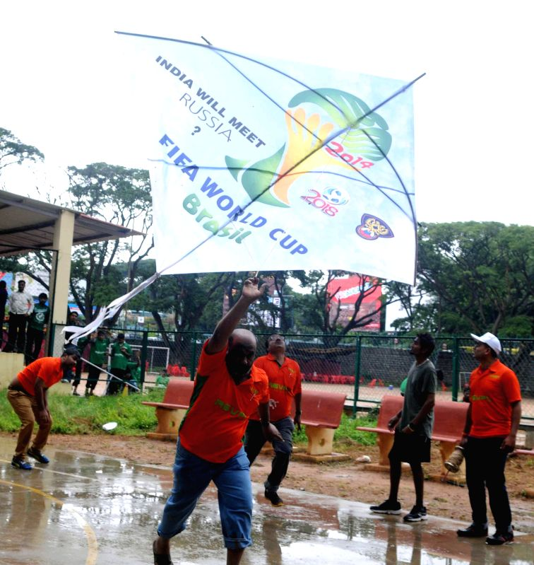 Kite enthusiast Kitty and his teammates fly a 18x18 kite themed on FIFA World Cup finals at BBMP Grounds in Bangalore on July 13, 2014.