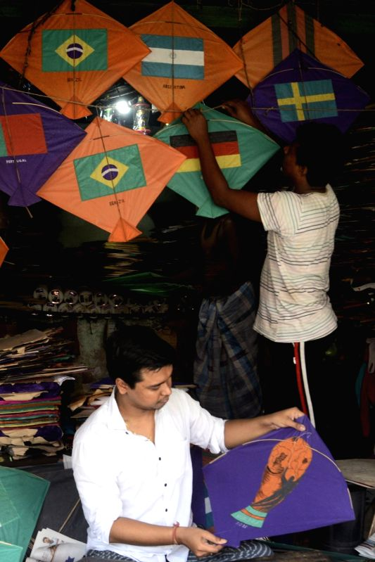 Kite makers busy making kites on the theme of FIFA World Cup 2018, in Kolkata on June 11, 2018.