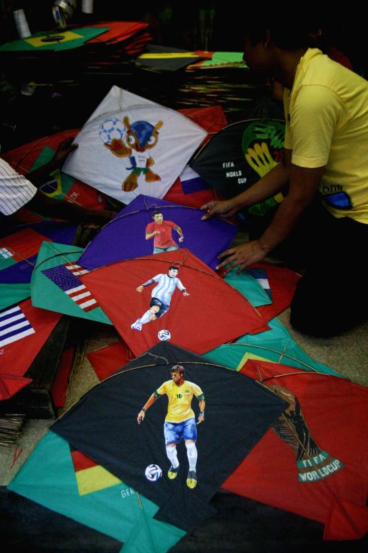 Kite makers display FIFA World Cup themed kites at their shop in Kolkata on June 20, 2014.