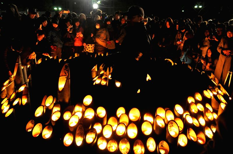 People light candles for the victims of the Great Hanshin Earthquake during a ceremony to mark the 20th anniversary of the earthquake in Kobe, western Japan, early ...