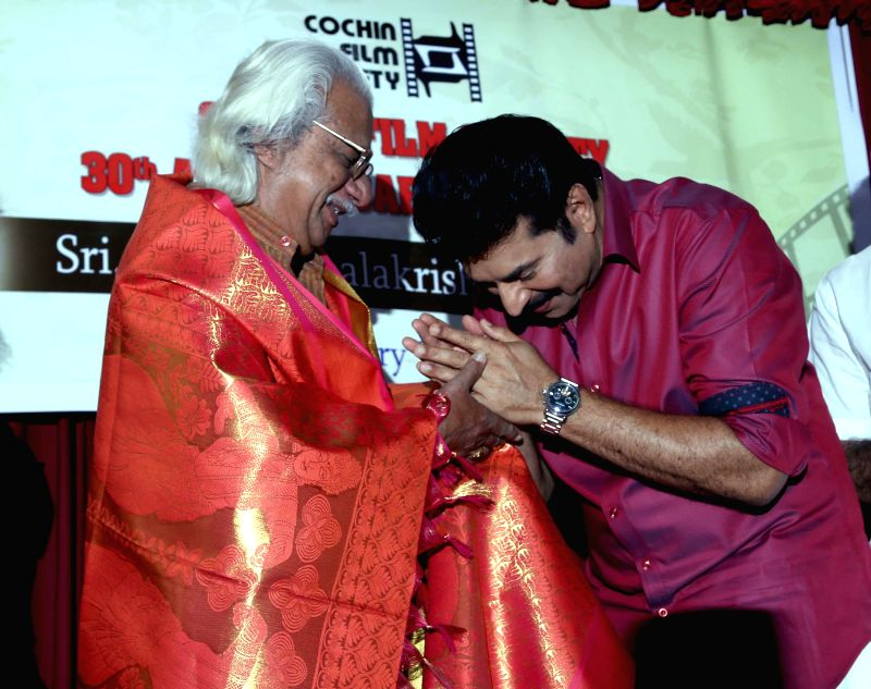 Actor Mammootty pay tribute to film director Adoor Gopalakrishnan during a felicitation ceremony in Kochi, on Feb 21, 2015.