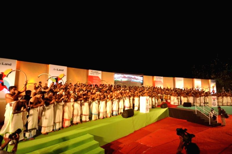 Artists perform during the inauguration of the second edition of Kochi-Muziris Biennale (KMB) in Kochio on Dec 12, 2014. As many as 305 artists performed together during the event which is ...