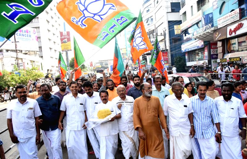 Kochi:  Union Minister Alphons Kannanthanam and BJP workers celebrate as the party led by Prime Minister Narendra Modi was set to retain power for another five years after making a sweep of the Lok Sabha battle and mauling the opposition; in Kochi, K