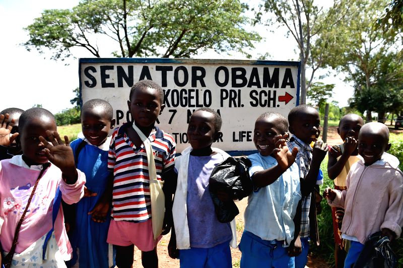 Pupils of Senator Obama Kogelo Primary School, which was renamed after Obama's visit as U.S. Senator in 2006, pose for photos outside the school at Kogelo Village in ...
