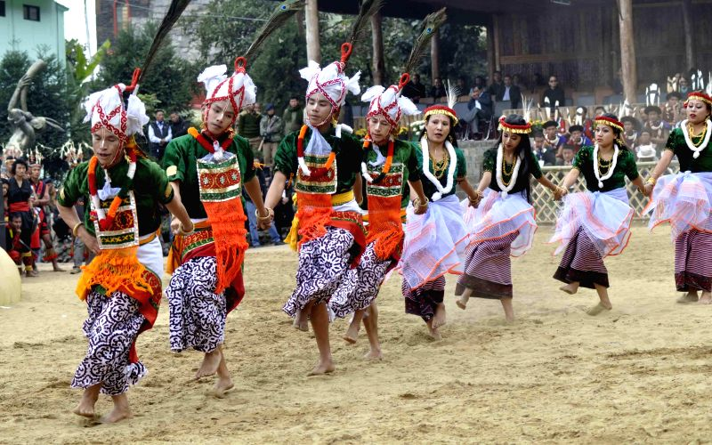 Artists perform traditional dance during the 10-day long Hornbill festival in Kisama village, located on the outskirts of Kohima, Nagaland.