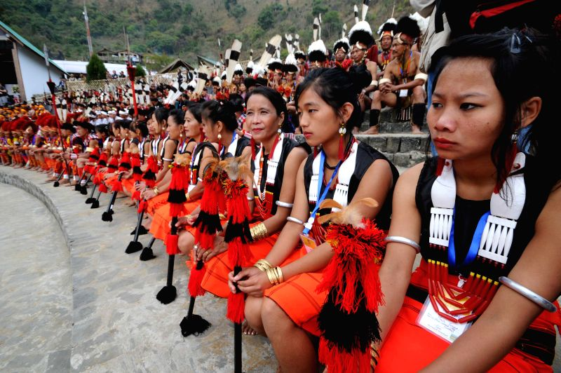 Naga women dressed in their traditional attire wait for their turn to perform during the 10-day long Hornbill festival in Kisama village, located on the outskirts of Kohima, Nagaland.