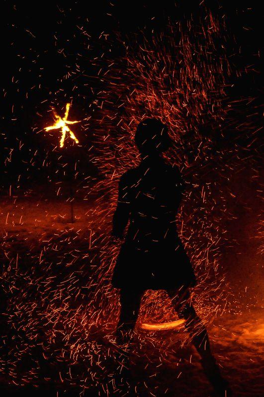 "KOHTLA-NOMME (ESTONIA), Feb. 8, 2015 A folk dancer performs in darkness during the ""Ash Mountain Dance Celebration"" in Kohtla-Nomme, northeastern Estonia on Feb. 7, 2015. More .."