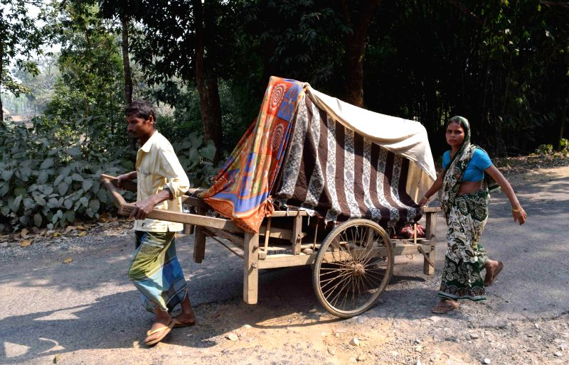 A man and his wife take their pregnant daughter to a Public Health Care centre located 5 km away from their village on a hand-drawn cart, only to find the centre closed, in Kokrajhar ...