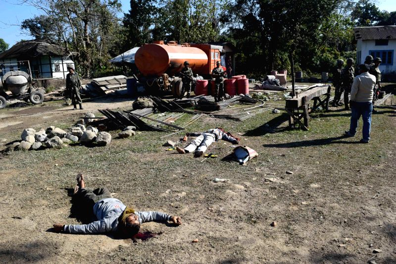 Bodies of villagers killed by Bodo militants who raided a Kokrajhar village on Tuesday (23rd December) lies on the ground on Dec 24, 2014.