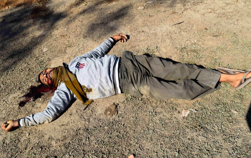 Body of a villager killed by Bodo militants who raided a Kokrajhar village on Tuesday (23rd December) lies on the ground on Dec 24, 2014.