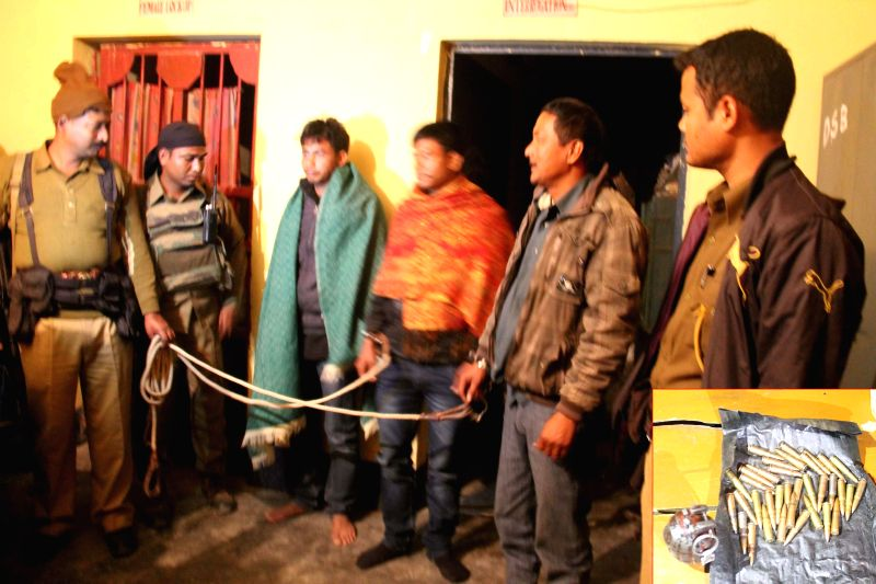 NDFB (S) cadres who were apprehended by security forces at Gosaigaon in Kokrajhar district of Assam on Dec 29, 2014. Arms and ammunition were also recovered from them.