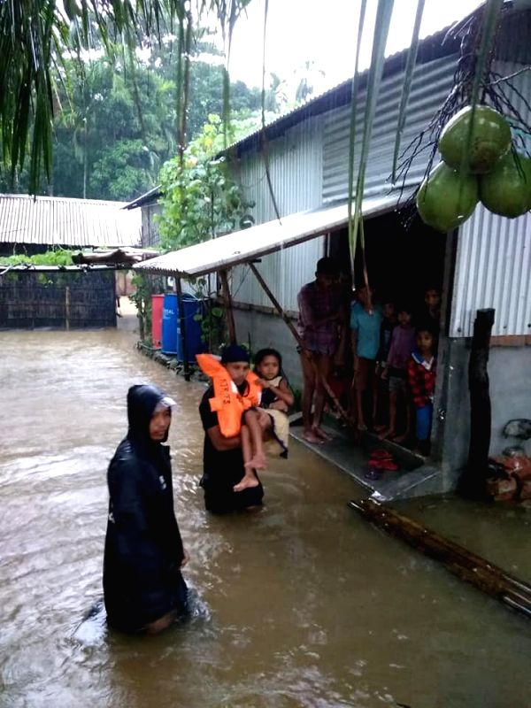 Kokrajhar: SDRF personnel carry out rescue operations in Assam's flood affected Kokrajhar, on July 24, 2019. (Photo: IANS)