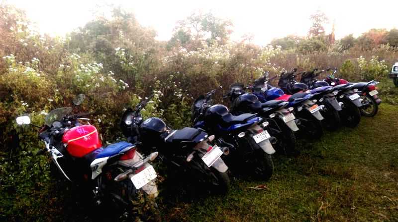 Security forces recover eight motorcycles including one imported bike and a car  from dense forest area in Khausi bazar forest of Assam's Kokrajhar on Dec 28, 2014.