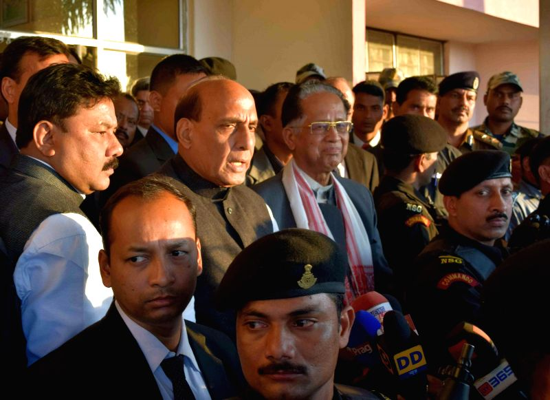 Union Home Minister Rajnath Singh and Assam Chief Minister Tarun Gogoi during their visit to violence hit Kokrajhar of Assam on Dec 25, 2014. - Rajnath Singh