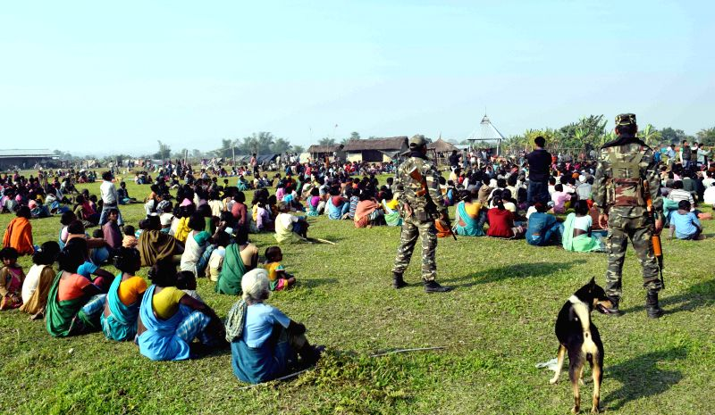 Villagers take refuge in makeshift relief camps without any basic amenities, in the wake of the recent violence in Assam that left 73 dead in Kokrajhar of Assam, on Dec 26, 2014.