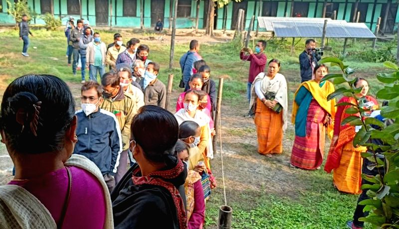 Kokrajhar: Voters queue up outside a polling station to cast their votes for the second phase of Bodoland Territorial Council (BTC) elections, in Assam's Kokrajhar district on Dec 10, 2020. (Photo: IANS)