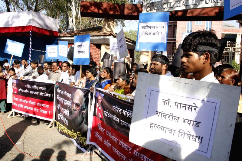 People protest in support of Veteran Left leader and anti-toll tax campaigner Govind Pansare and his wife Uma Pansare who were shot near their home in Kolhapur, Maharashtra on Feb 16, 2015.