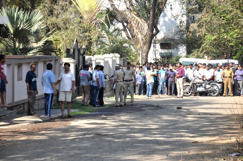 Police officers investigating at the scene of the crime where Veteran Left leader and anti-toll tax campaigner Govind Pansare and his wife Uma Pansare were shot near their home in Kolhapur,