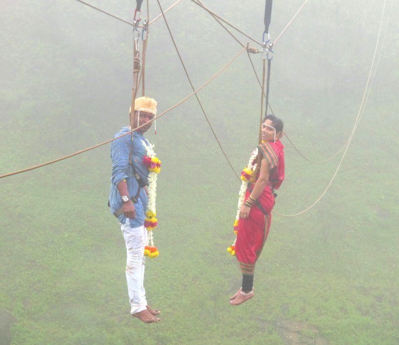 Kolhapur\'s Jaideep Jadhav and Reshma Patil got married mid-air 600-feet above Western Ghats in Kolhapur, hanging on ropes, on Sunday afternoon. PIX by  MAYUR LAWATE. - Reshma Patil